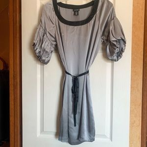 Silk gray dress with blouson sleeves.